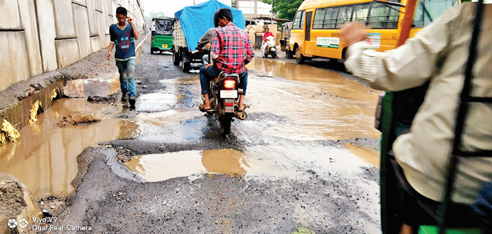 Big holes in road after heavy rain