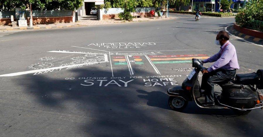 painiting for corona awareness at memnagar cross roads